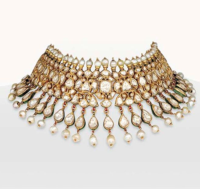 A DIAMOND AND PEARL INDIAN CHOKER NECKLACE The flexible choker designed as a panel of foil-backed vari-shaped table-cut diamonds, to the pear-shaped table-cut diamond and pearl fringe and single-row pearl surmount, the reverse decorated with red and green poppy flowers on white enamel ground, mounted in gold, 13¾ ins. (length adjustable)
