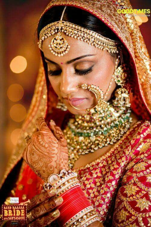 The perfect Indian bride with statement jewellery, red chura and also a wrist watch #weddingideas #wedfine