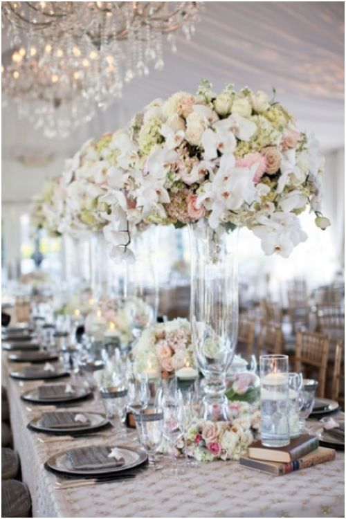 Grand Centerpiece Featuring White Phalenopsis Stock Hydrangea Roses And Other Flowers In A Dome Shape On Top Of Curved Gl Vase