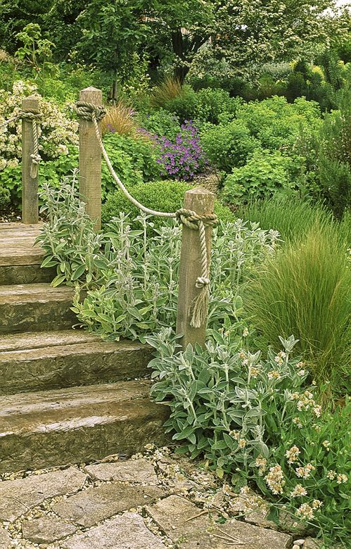 Sleeper Steps. Nice to have posts alongside, but perhaps a longer lasting hand rail