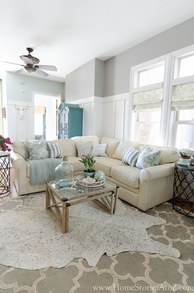 Gray Living Room Paint Color is Dorian Gray by Sherwin-Williams. Foyer paint color, seen from living room is Sea Salt by Sherwin-Williams. Home Stories A to Z via Favorite Paint Colors Blog.