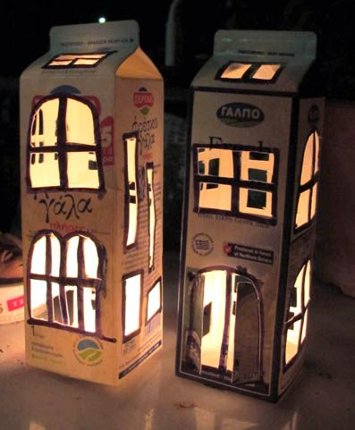 "I made these ""light houses"" from used milk boxes. The little secret is that you have to make many little openings so the plastic inside will not be burned."