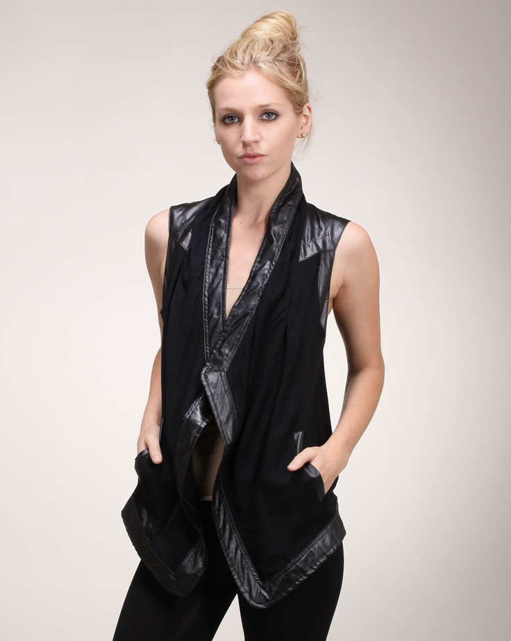 Cheryl says: Feel rocker chic in this edgy yet stunning contrast trim vest. The neck and hem are both embellished with a shinier trim while the rest of the vest has a smooth, deep black color. Pockets add more versatility to this look, which is already bound to become a wardrobe staple.