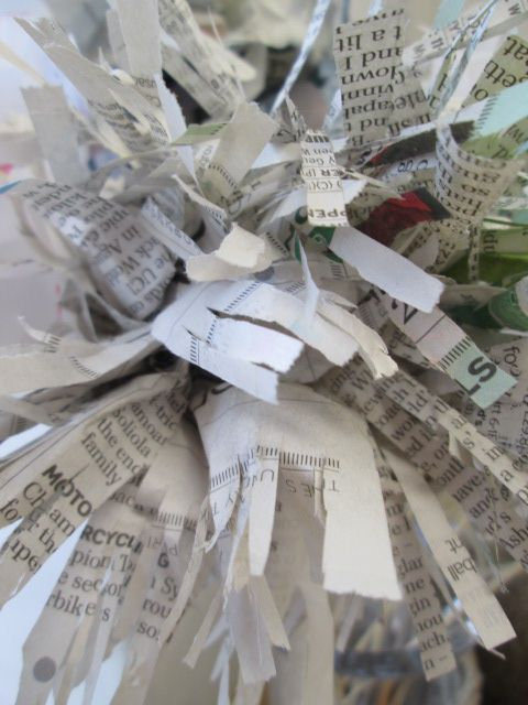 Paper flowers made from newspaper decorate the shop.