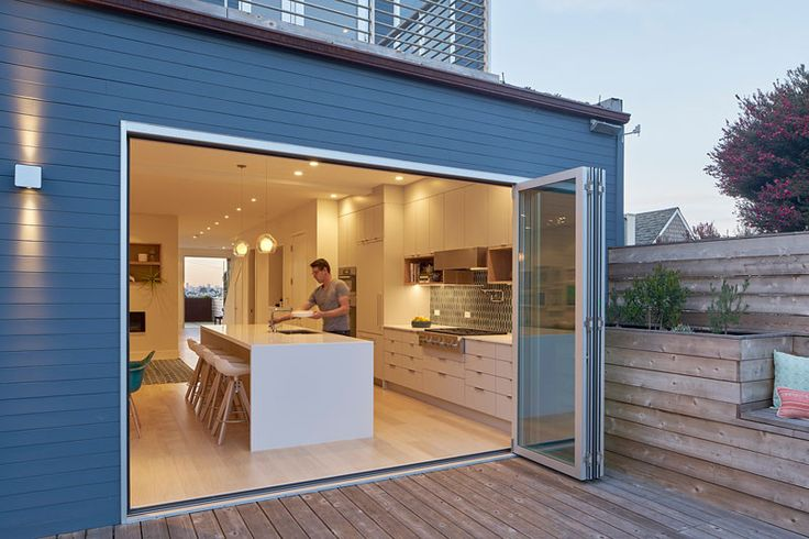 Folding doors open directly into back yard. Randall Street House by YAMAMAR Design Architects