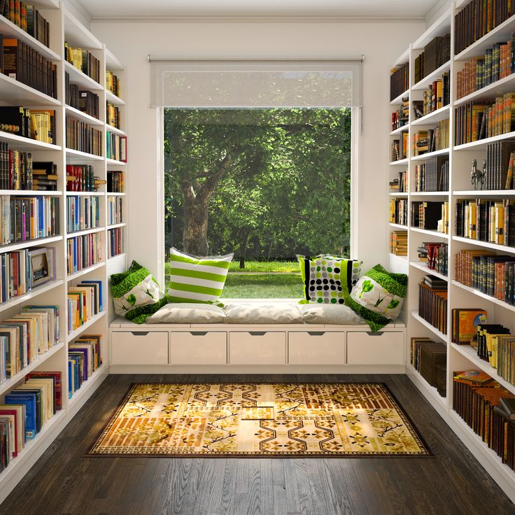 reading area under window of library with green pillows