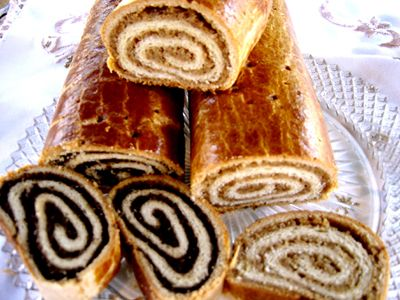 Makos / Dios Beigli.     Beigli (or sometimes spelled bejgli) is a real Hungarian Christmas treat. The lighter filling is walnut the darker is poppy seed.    These bring back fond childhood memories of which I remember them tasting amazing!