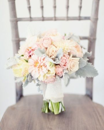 Dahlias, garden roses, parrot tulips, and dusty miller bouquet