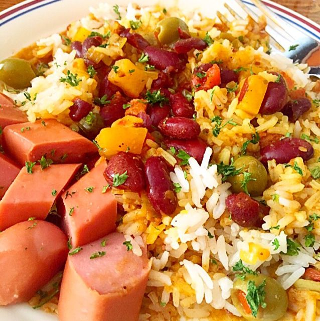 Traditional Puerto Rican side served over rice. - Habichuelas (Puerto Rican Red Beans)