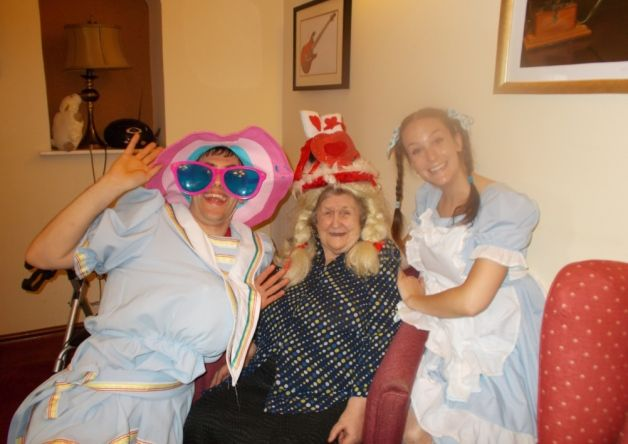 Resident Annabel Adair with two of the panto actors