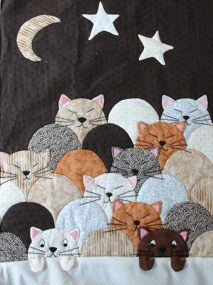 Chats quiltés (Cat quilt). Great composition; note the little sweetie in lower left who can't sleep!  Beauce - Arts Textiles (Mai 2012).