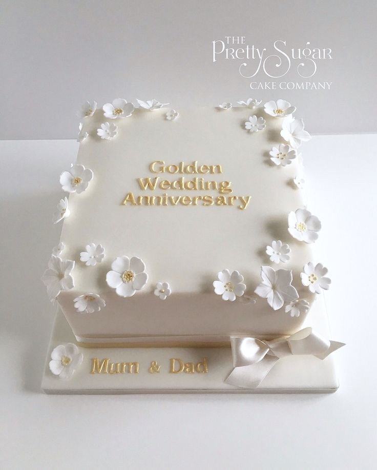Golden wedding anniversary cake with white and gold blossoms
