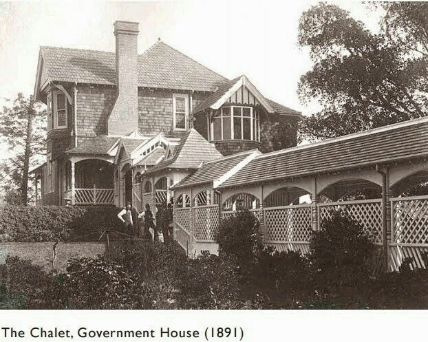 The Chalet at the Government House estate in 1891.The Chalet,designed by Walter Liberty Vernon to sit immediately adjacent to the Gothic Revival Government House designed by Edward Blore,is a substantial timber residence built to accommodate the Governor's Chief of Staff.