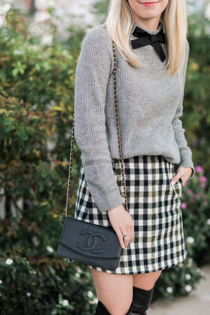 Bow Sweater and Plaid Skirt Via Rhyme and Reason. Plaid skirt outfit, bow sweater outfit, winter outfit, cold weather outfit, casual holiday outfit.