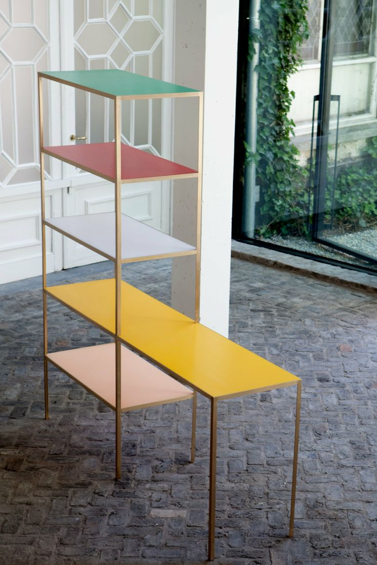 Rack + Table in brass by Muller Van Severen, uniting a shelf and a table in one streamlined composition.