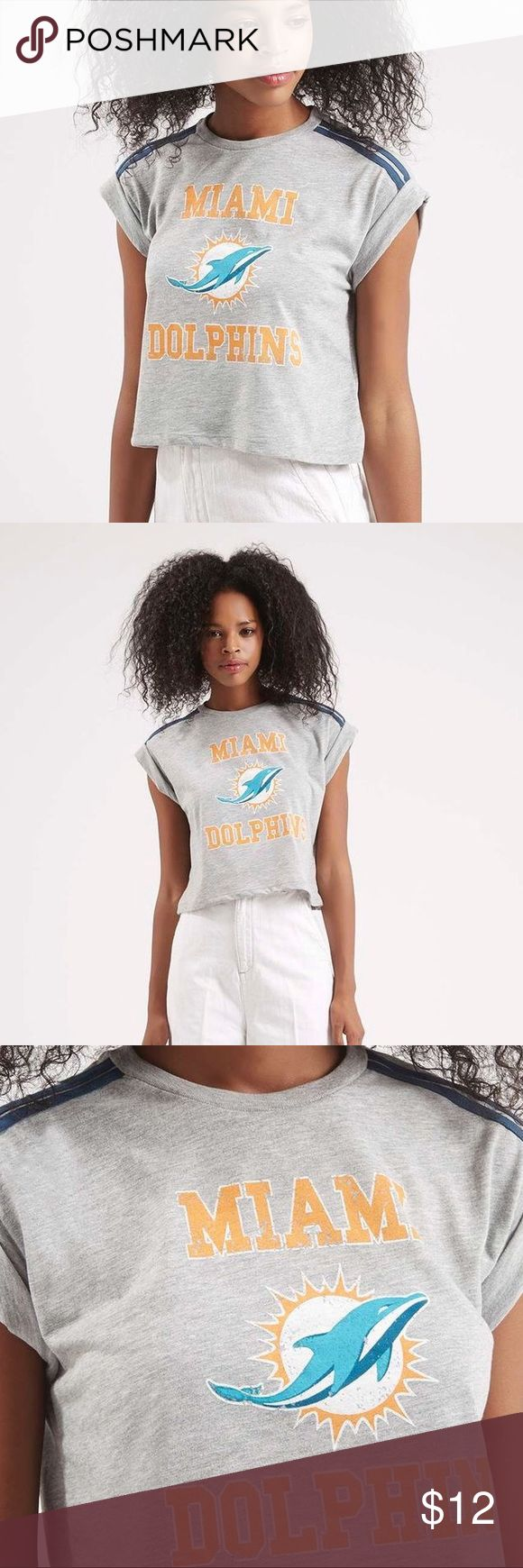 Tee & Cake Top Shop Miami Dolphins Crop Top NWOT Grey Miami Dolphins Tee & Cake Top Shop crop top. US size 12. Perfect with jean shorts and your favorite pair of Converse. 70% Polyester 30% Cotton machine wash Tee & Cake Top Shop Tops Crop Tops