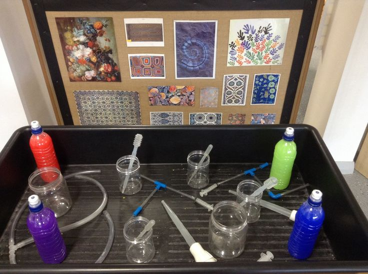 Investigation area. Enhanced with brightly coloured water (just using a small squirt of paint!), transparent pipettes, jars, tubes etc. encouraging the children to explore with colour mixing, and allowing them to watch the water travel through the various objects.