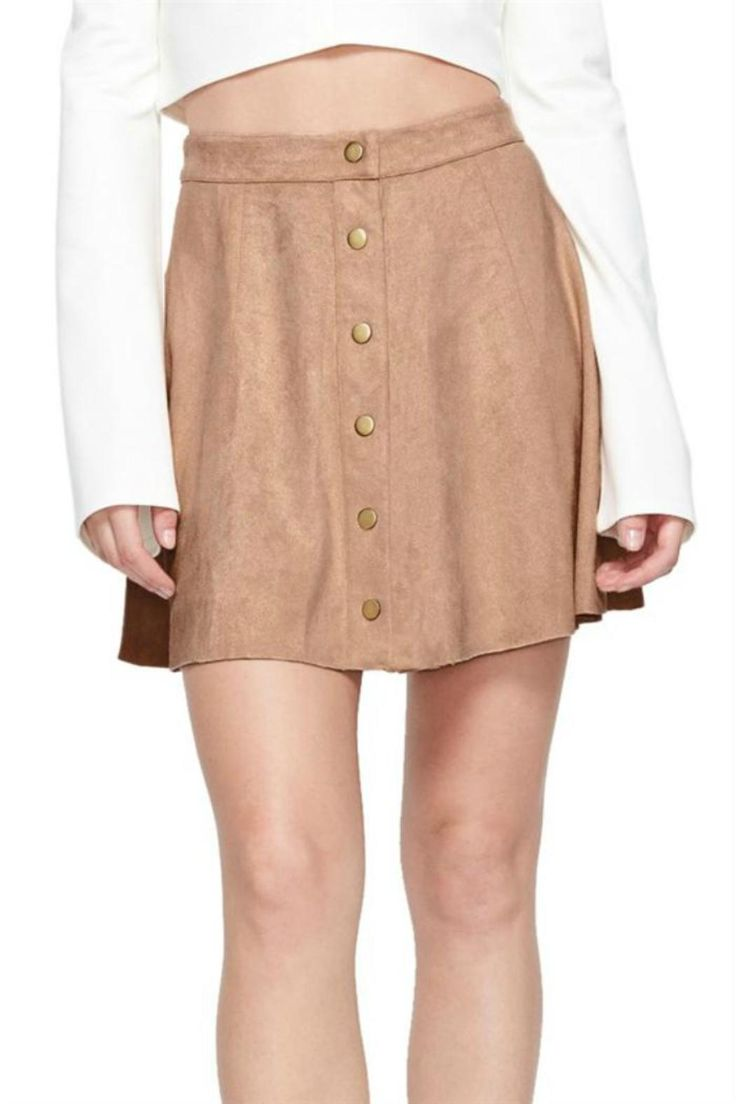 "Super soft faux suede mini-skirt. Featuring stylish brass front button closure. Flowy silhouette paneled design. Falls 18"" in length.  Lady In Suede by Soprano. Clothing - Skirts Fayetteville Arkansas"