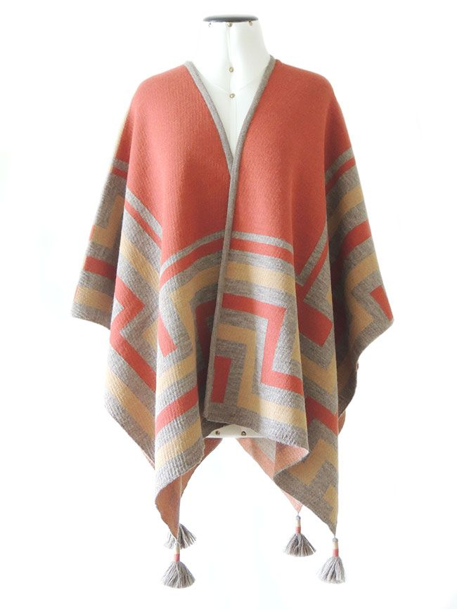 Ruana wrap, red-ocre-sand, with graphic design  in 100%  soft  baby alpaca. with 4  tassels