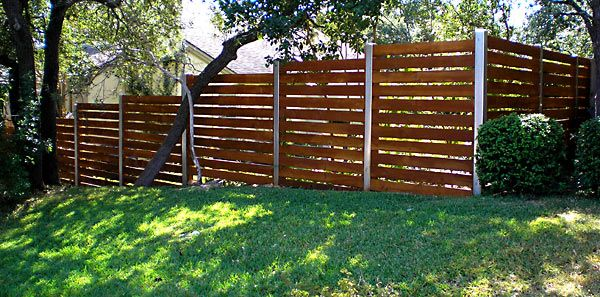 Horizontal Wood Slats With Dark Stain And Metal Posts