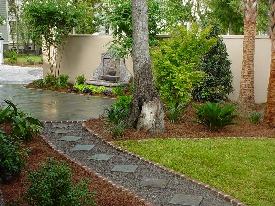 Diamond stepping stones set in gravel paths and walkways for Affordable walkway ideas