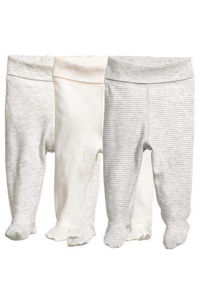 CONSCIOUS. Pantalones en punto suave de algodón orgánico. Modelo con cintura elástica ancha plegable y pies.