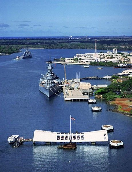 """USS Missouri and the Arizona Memorial at Pearl Harbor, Honolulu, Hawaii. the Japanese surrender was signed aboard the U.S.S. Missouri; aka the """"Might Mo"""" and so it is fitting that she is permanently anchored next to the U.S.S. Arizona in Pearl Harbor."""