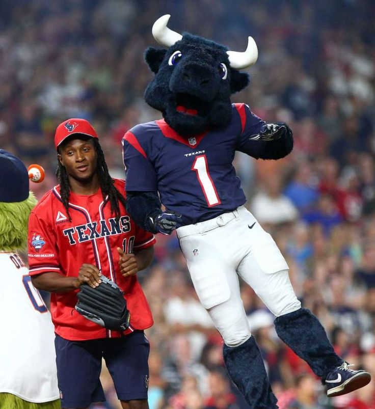 Houston Texans wide receiver DeAndre Hopkins (10) takes the field with Toro during the 4th annual J. J. Watt Charity Classic at Minute Maid Park Saturday, May 14, 2016, in Houston.
