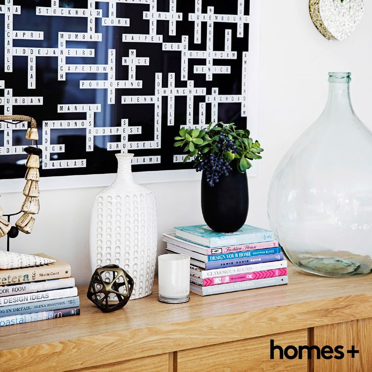 A #scrabble #board has been turned into an #artwork in Jaclyn's #beachhouse. As featured in the April 2015 issue of homes+. #vase #books #ornaments #vessel #heart #pot #candle #interior #decor #beachhouse #homesplusmag
