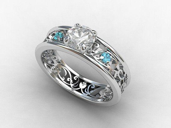 Filigree engagement ring with White sapphire and aquamarines by TorkkeliJewellery, $1990.00