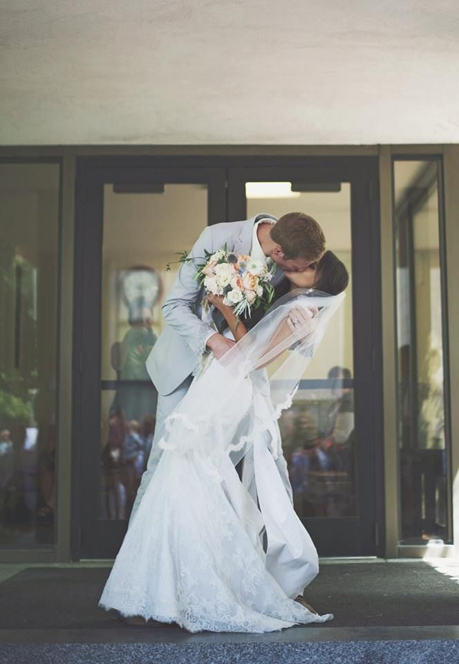 Kiss!  Modest wedding dress - temple wedding   Image by Tiffany Barton