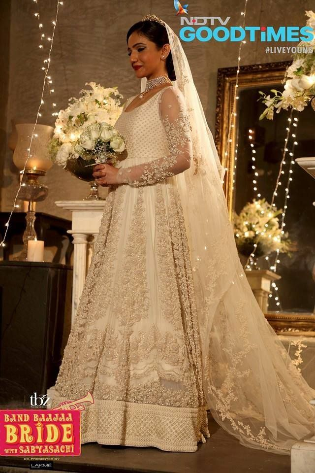 Floor length white on white, resham and pearl work embellished outfit by Sabyasachi