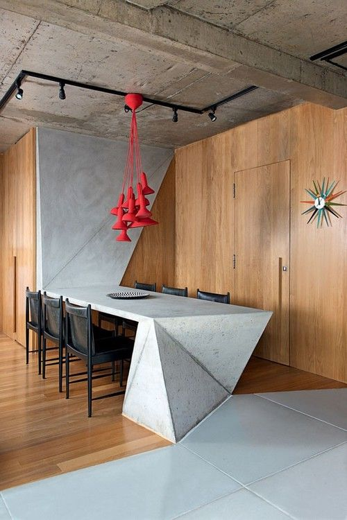 This angular concrete table is built into the space. How inventive! #industrial…