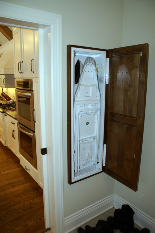 Hide it. Installing an ironing board in a hideaway drawer or cabinet is an ideal laundry solution for many homeowners. Not only can you conveniently tuck your ironing board away at the drop of the hat, but it provides a stationary and solid ironing station without taking up any additional room.