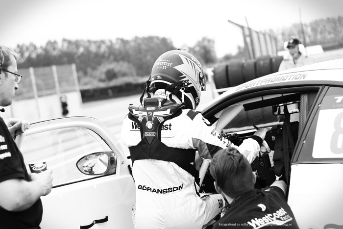 "Richard Göransson i depån innan stundande race, som han dessutom vann. Från Falkenberg i somras. A picture of Swedish TTA driver Richard Göransson as he was about to race. He later won the race. The picture was taken at ""Falkenbergs Motorbana"" in the summer of 2012.  #tta #bmwsilhouettereplica #people #blackandwhitephotography #bw #blackandwhite #svartvitt #racing #motorsport #car #bil #cars #bilar #photography #foto"