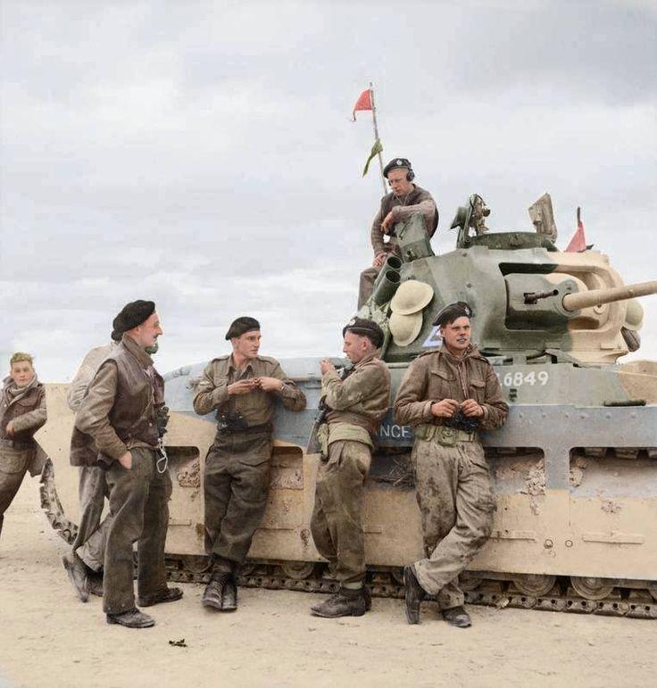 The crew of A12 Matilda MkII 'Defiance' (T 6849), 4th Royal Tank Regiment, 32nd Army Tank Brigade, take a break during the fighting near Tobruk, Libya. 28 November 1941