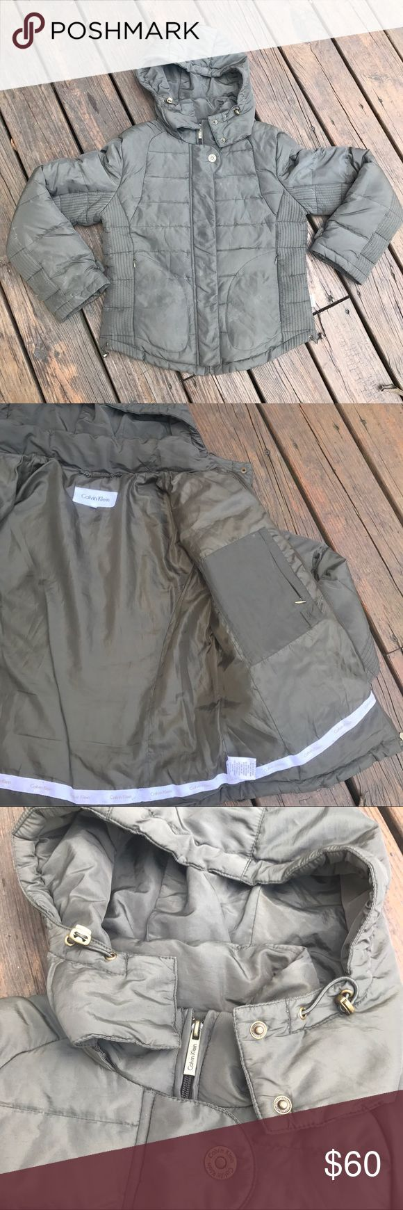 Calvin Klein down puffer coat Dark taupe grayish color - has a removable hood that has adjustable least around your head / the waist band also has an adjuster to keep the wind out - 2 discreet outside pockets and 1 lapel pocket on inside - no signs of ware little use Calvin Klein Jackets & Coats Puffers