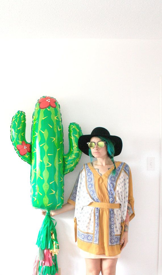Cactus Balloon : 1 giant 36 inch mylar balloon (shipped uninflated of course) can be inflated with air or helium  a string of twine with tissue paper tassels a straw to blow up balloon with air.   Just tie or tape balloon to garland once inflated.  Etsy