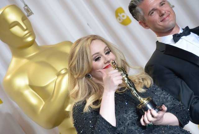 Adele with her Oscar for Best Achievement in Music Written for Motion Pictures, Original Song