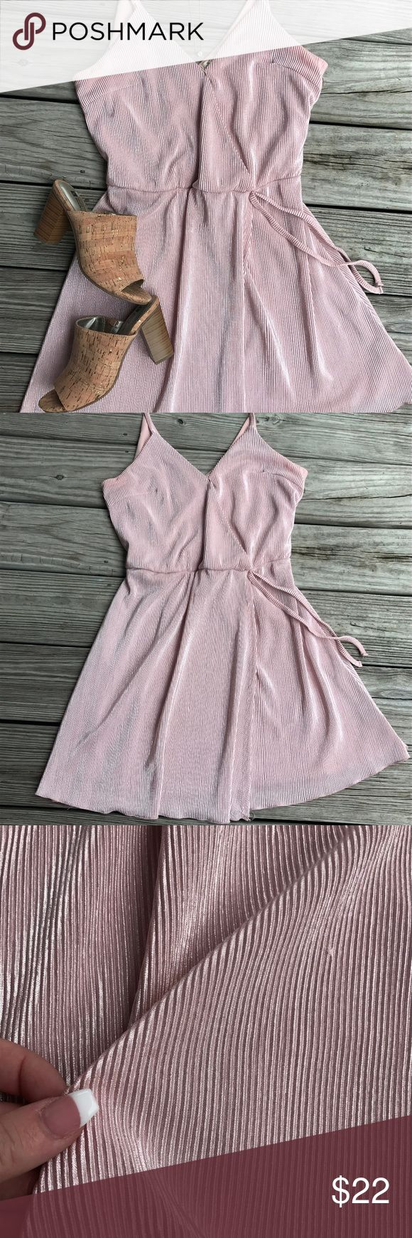 Pink Pearl A Line Sun Dress Fabric is breezy and soft. Amazing sheen and shine! This dress will make you sparkle. Condition is really good and I have worn it about 3 times. Really flattering waist line. Not lined from the waist down so make sure you wear neutral underwear or a slip! Tiny spot of discoloration on the back, not noticeable but will send pictures if requested. Ultra Flirt Dresses Mini