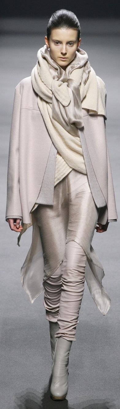 Haider Ackermann  She collected all shades of nude tones..  Without any focus point, it's just a painting that looks like a background!