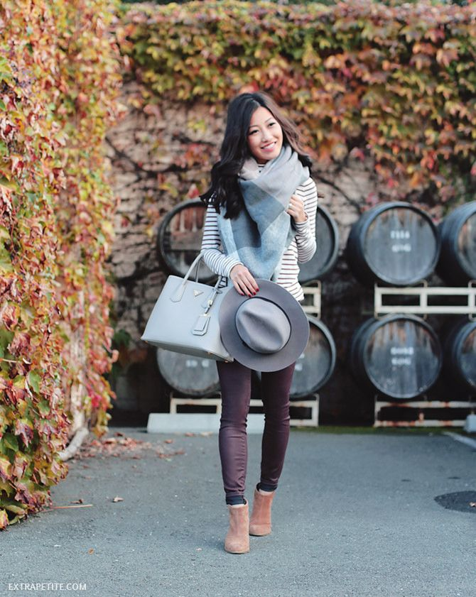 Black-and-white striped top, gray plaid blanket scarf, burgundy jeans, tan ankle boots