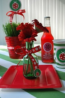 ladybug party centerpieces?  maybe a combination of the grasses and the flowers?