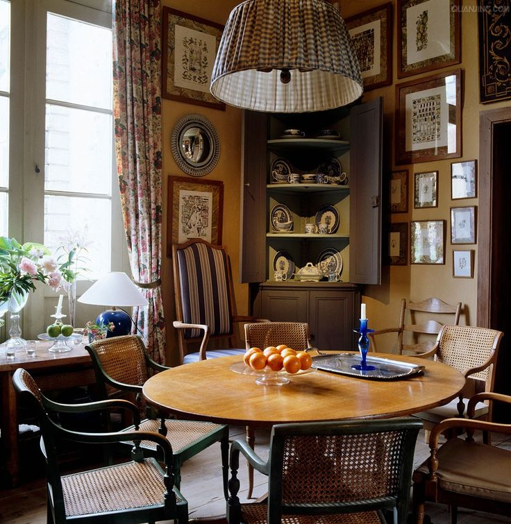 Axel Vervoordt A Collection Of Cane Backed Chairs Surround Circular Table In This Elegant But Small Breakfast Room