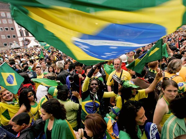 Soccer Fans Brazil soccer fans celebrate their team's victory in a match with Ghana at the World Cup in Dortmund, Germany, in 2006. The nation formed its first official team in 1914 and now boasts what is arguably the most successful national soccer team in the world.