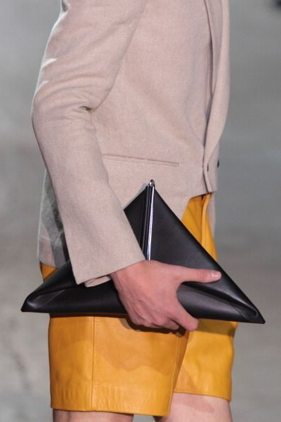 New rule of men's fashion: Man clutches look modern in geometric shapes.