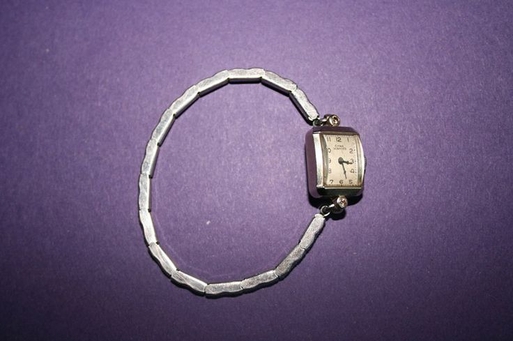 CYMA TAVANNES ANTIQUE WATCH Minimum bid: $180  An antique hand-wind watch for women, in working order, product of Cyma Tavannes, Swiss movement, 17 stones, caliber # 43637, square white face in 14 K white gold with two little diamonds, bracelet in white metal.   Appraised by Le Parchemin Jewellers in Montreal, May 2007. A copy of the appraisal is available upon request.  Bid here: www.facebook.com/cause4paws  See the rest of this album for other items!