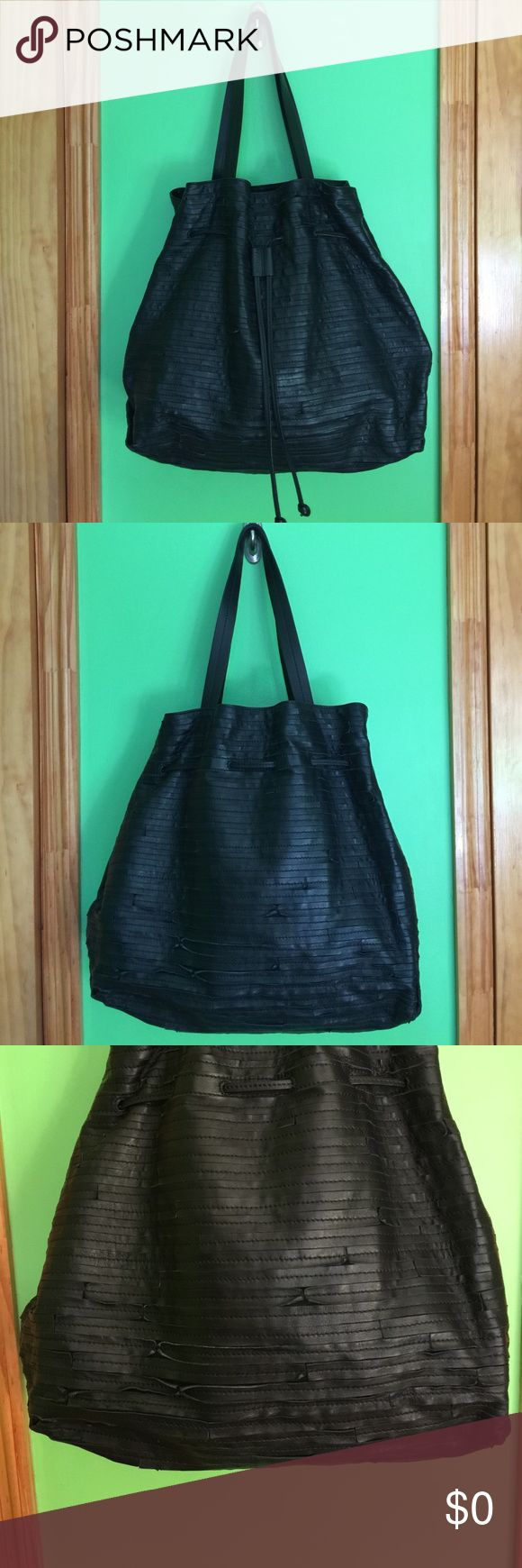 Whistles Caracas Duffle Bag Used with care, Whistles Caracas Duffle Bag, purchased at Bloomingdale's. Overall, the bag is in excellent condition, some of the leather strips on the bag has curled up from wear.  One of the handles there are two small deep scratches (see photo).  Bag is very roomy, great for school, travel or to tote around.   Comes with dust bag.  Bag is 100% leather. Whistles Bags Totes