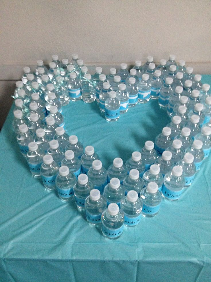 Custom water bottles ~ *Fill heart center with lit candles and short centerpiece!