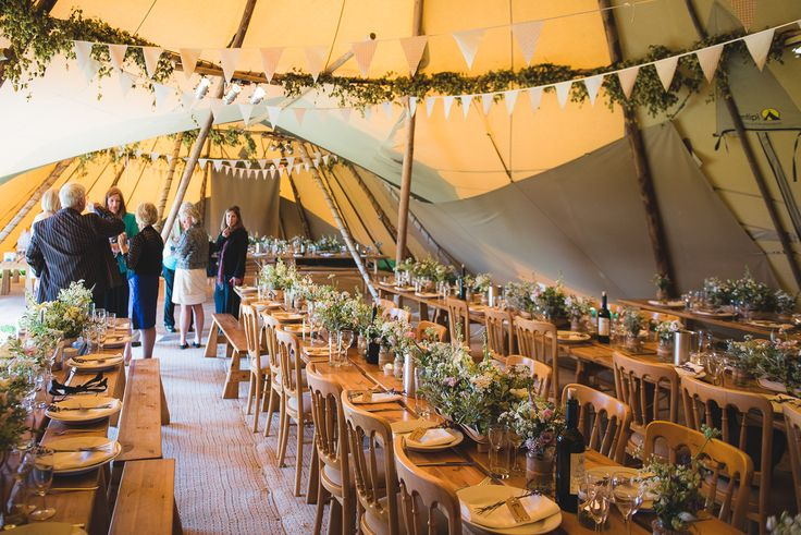 Dried hop bines, bunting and lots and lots of lovely flowers create dining tipis to die for! Tipis by beautifulworldtents.co.uk, photography by lifeinfocusphotography.co.uk